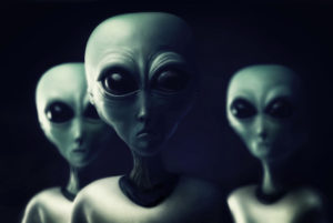 Photo realistic illustration created in Photoshop and other illustration applications. Three aliens approach in the night. What do they want Where are they from Who knows